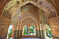 """Arabesque Moorish stalactite or morcabe architecture  of the Palacios Nazaries, Alhambra. Granada, Andalusia, Spain. . The Alhambra is a palace and fortress complex located in Granada, Andalusia, Spain. It was originally constructed as a small fortress in 889 CE on the remains of ancient Roman fortifications. The Alhambra was renovated and rebuilt in the mid-13th century by the Arab Nasrid emir Mohammed ben Al-Ahmar of the Emirate of Granada, who built its current Alhambra palace and walls. The Alhambra was converted into a royal palace in 1333 by Yusuf I, Sultan of Granada. The decoration of The Alhambra consists for the upper part of the walls, as a rule, of Arabic inscriptions—mostly poems by Ibn Zamrak and others praising the palace—that are manipulated into geometrical patterns with vegetal background set onto an arabesque setting (""""Ataurique""""). Much of this ornament is carved stucco (plaster) rather than stone. Tile mosaics (""""alicatado"""") of The Alhambra, with complicated mathematical patterns (""""tracería"""", most precisely """"lacería""""), are largely used as panelling for the lower part. .<br /> <br /> Visit our SPAIN HISTORIC PLACXES PHOTO COLLECTIONS for more photos to download or buy as wall art prints https://funkystock.photoshelter.com/gallery-collection/Pictures-Images-of-Spain-Spanish-Historical-Archaeology-Sites-Museum-Antiquities/C0000EUVhLC3Nbgw <br /> .<br /> Visit our ISLAMIC HISTORICAL PLACES PHOTO COLLECTIONS for more photos to download or buy as wall art prints https://funkystock.photoshelter.com/gallery-collection/Islam-Islamic-Historic-Places-Architecture-Pictures-Images-of/C0000n7SGOHt9XWI"""
