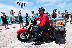 Roger Green riding his 1937 Harley-Davidson ULH Flathead in the Cross Country Chase motorcycle endurance run from Sault Sainte Marie, MI to Key West, FL. (for vintage bikes from 1930-1948). The Grand Finish in Key West's Mallory Square after the 110 mile Stage-10 ride from Miami to Key West, FL and after covering 2,368 miles of the Cross Country Chase. Sunday, September 15, 2019. Photography ©2019 Michael Lichter.
