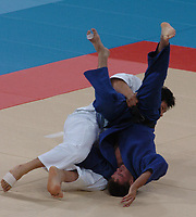 Song Pan (China,white) in his bout with Yury Rybak (Belarus) Mens 100kg+ Judo, Athens Olympics, 20/08/2004. Credit: Colorsport / Matthew Impey DIGITAL FILE ONLY