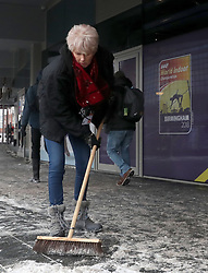 Staff and Volunteers clear the outer concourses around the arena prior to day two of the 2018 IAAF Indoor World Championships at The Arena Birmingham.