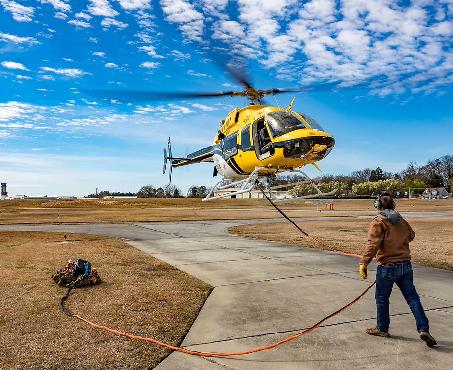 Demonstration flight of the Vita Inclinata Load Stabilizing System (LSS) at Atlanta's Dekalb Peachtree Airport, during the 2019 Heli Expo.<br /> <br /> Created by aviation photographer John Slemp of Aerographs Aviation Photography. Clients include Goodyear Aviation Tires, Phillips 66 Aviation Fuels, Smithsonian Air & Space magazine, and The Lindbergh Foundation.  Specialising in high end commercial aviation photography and the supply of aviation stock photography for advertising, corporate, and editorial use.