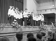Vienna Boys Choir.   (P5)..1981..25.11.1981..11.25.1981..25th November 1981..The Vienna Boys Choir performed a concert at the Royal Dublin Showgrounds (RDS),Concert Hall,  Ballsbridge, Dublin, last night. A packed audience enjoyed the recital from the world renowned choir...Under the guidance of the director/pianist a soloist from the choir is pictured performing for the packed audience at the RDS Concert Hall.