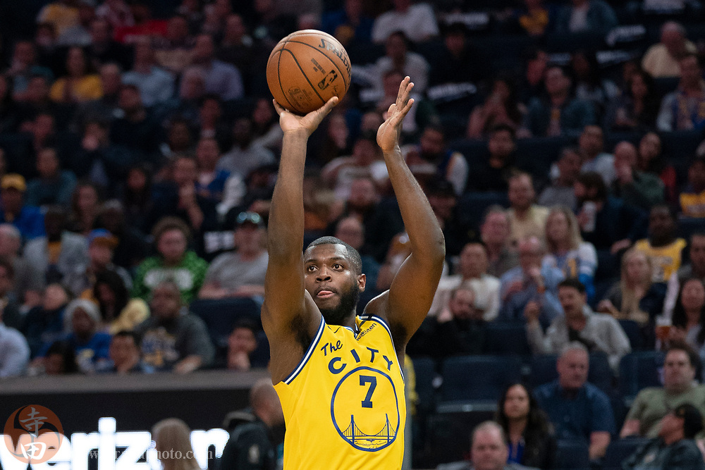 February 27, 2020; San Francisco, California, USA; Golden State Warriors forward Eric Paschall (7) shoots the basketball against the Los Angeles Lakers during the third quarter at Chase Center.