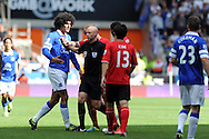 The referee Anthony Taylor has words with Everton's Marouane Fellaini (l).   Barclays Premier league, Cardiff city v Everton at the Cardiff city Stadium in Cardiff,  South Wales on Saturday 31st August 2013. pic by Andrew Orchard,  Andrew Orchard sports photography,
