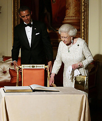 Queen Elizabeth II arrives to sign the guest book as she bids farewell to US President Barack Obama and First Lady Michelle Obama, watch by the Duke of Edinburgh at Winfield House - the residence of the Ambassador of the United States of America - in Regent's Park, London.