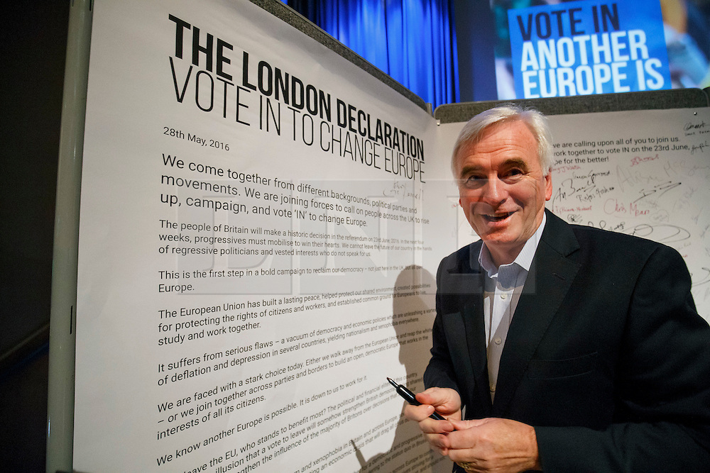 "© Licensed to London News Pictures. 28/05/2016. London, UK. Labour Shadow Chancellor JOHN MCDONNELL signs a declaration after speaking at ""Another Europe is Possible"" rally at UCL Institute of Education in London, campaigning for a remain vote at the upcoming EU referendum.  Speakers at the event include former Greek Finance Minister Yanis Varoufakis and Green Party MP Caroline Lucas. Photo credit: Tolga Akmen/LNP"
