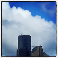 2018 MAY 10 - Buildings against clouds and blue sky in downtown Seattle, WA, USA. Taken/edited with Instagram App for iPhone. By Richard Walker