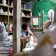May 14, 2013 - Mandalay, Myanmar: A local woman sands a buddha statue in a traditional workshop, in Mandalay, dedicated to the production of religious paraphernalia. CREDIT: Paulo Nunes dos Santos
