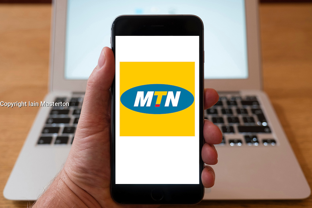 Using iPhone smartphone to display logo of MTN the South Africa-based multinational mobile telecommunications company