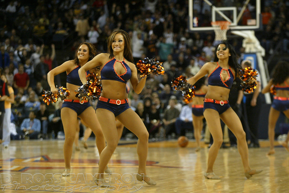 The Warrior Girls cheerleaders entertain the crowd during a timeout in an NBA basketball game between the Utah Jazz and Golden State Warriors, Monday, Feb. 27, 2006 at the Arena in Oakland, Calif. (D. Ross Cameron/The Oakland Tribune)