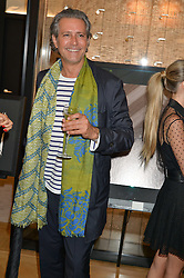 CARLOS SOUZA at a private view of photographs by Astrid Munoz entitled Unbridled Synchrony hosted by  Jaeger-LeCoultre at their boutique at 13 Old Bond Street, London on 13th July 2015.
