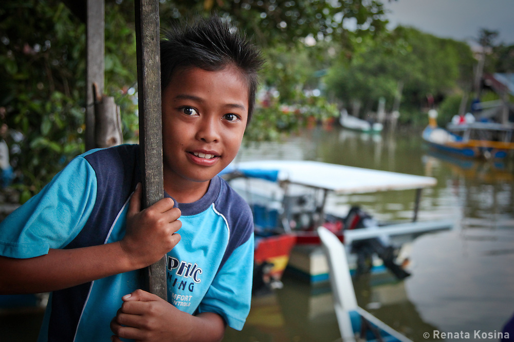 Malaysian boy in a fishing village - island of Langkawi, Malaysia