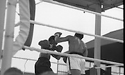 Ali vs Lewis Fight, Croke Park,Dublin..1972..19.07.1972..07.19.1972..19th July 1972..As part of his built up for a World Championship attempt against the current champion, 'Smokin' Joe Frazier,Muhammad Ali fought Al 'Blue' Lewis at Croke Park,Dublin,Ireland. Muhammad Ali won the fight with a TKO when the fight was stopped in the eleventh round...A left cross by Ali sends Lewis back across the ring.