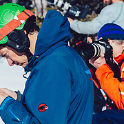 Eric Seymour texts Jess McMillan a photo of the line she is about to ski with Wade McKoy photographing him doing so.