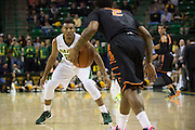 WACO, TX - JANUARY 5: King McClure #22 of the Baylor Bears defends against the Oklahoma State Cowboys on January 5, 2016 at the Ferrell Center in Waco, Texas.  (Photo by Cooper Neill/Getty Images) *** Local Caption *** King McClure