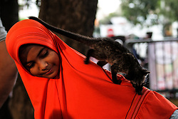 February 4, 2018 - Lhokseumawe, Aceh, Indonesia - A girl play with dangerous pets such as reptiles during the National Primate Day campaign in Lhokseumawe, Aceh, Indonesia on February 4, 2018.Animal Lovers in Lhokseumawe commemorate the national Primate Day which falls on January 30, to provide education about dangerous pets to the public. Increase public awareness to stop hunting, commerce, and destruction of primate habitat in Indonesia. (Credit Image: © Fachrul Reza/NurPhoto via ZUMA Press)