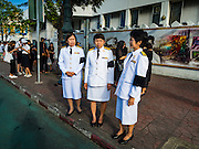 20 OCTOBER 2016 - BANGKOK, THAILAND:  Thai civil servants in their formal uniforms, with black mourning bands on the arms, wait to walk into the Grand Palace to pay respects to the late Bhumibol Adulyadej, the King of Thailand. The King died Oct. 13, 2016. He was 88. His death came after a period of failing health. Bhumibol Adulyadej was born in Cambridge, MA, on 5 December 1927. He was the ninth monarch of Thailand from the Chakri Dynasty and is also known as Rama IX. He became King on June 9, 1946 and served as King of Thailand for 70 years, 126 days. He was, at the time of his death, the world's longest-serving head of state and the longest-reigning monarch in Thai history.      PHOTO BY JACK KURTZ