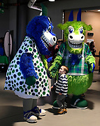 Hartford Yard Goats mascots Chew Chew, left, and Chompers greet a small fan during a game between the Yard Goats and Richmond Flying Squirrels at Dunkin' Donuts Park in Hartford, Conn., on Tuesday, April 16, 2019. (AP Photo/Jessica Hill)