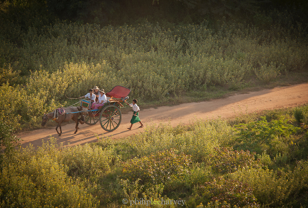Tourists visit the thousands of temples and pagodas by horse and cart, in the ancient city of Bagan, Myanmar