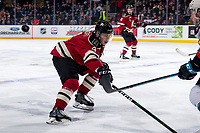 KELOWNA, BC - FEBRUARY 15: Christoffer Sedoff #4 of the Red Deer Rebels stick checks Kyle Topping #24 of the Kelowna Rockets as he tips the puck into the defensive zone at Prospera Place on February 15, 2020 in Kelowna, Canada. (Photo by Marissa Baecker/Shoot the Breeze)