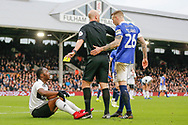 Fulham midfielder Neeskens Kebano (7) is booked, yellow card for simulating a dive after a challenge from Oldham Athletic defender Peter Clarke (26) during The FA Cup 3rd round match between Fulham and Oldham Athletic at Craven Cottage, London, England on 6 January 2019.