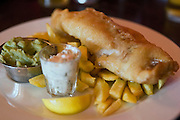 Fish and chips are being served at The Durham Ox restaurant, in Crayke, Yorkshire, England, United Kingdom.