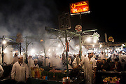 Cooks wait to grill kebabs and sausages for hungry customers in the open air market at Djemaa El-Fna square in the heart of the Marrakech medina, Morocco on November 16, 2007. The plaza bustles with food stalls and performers of all sorts till late every night.