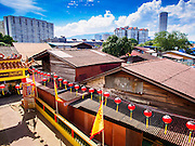 "06 OCTOBER 2014 - GEORGE TOWN, PENANG, MALAYSIA: The roofline of a Chinese community as seen from the Hean Boo Thean Kuanyin temple on one of the ""clan jetties"" in George Town (also Georgetown), the capital of the state of Penang in Malaysia. The ""clan jetties"" are the traditional homes of Chinese people who originally settled in the area centuries ago. Named after Britain's King George III, George Town is located on the north-east corner of Penang Island. The inner city has a population of 720,202 and the metropolitan area known as George Town Conurbation which consists of Penang Island, Seberang Prai, Kulim and Sungai Petani has a combined population of 2,292,394, making it the second largest metropolitan area in Malaysia. The inner city of George Town is a UNESCO World Heritage Site and one of the most popular international tourist destinations in Malaysia.      PHOTO BY JACK KURTZ"