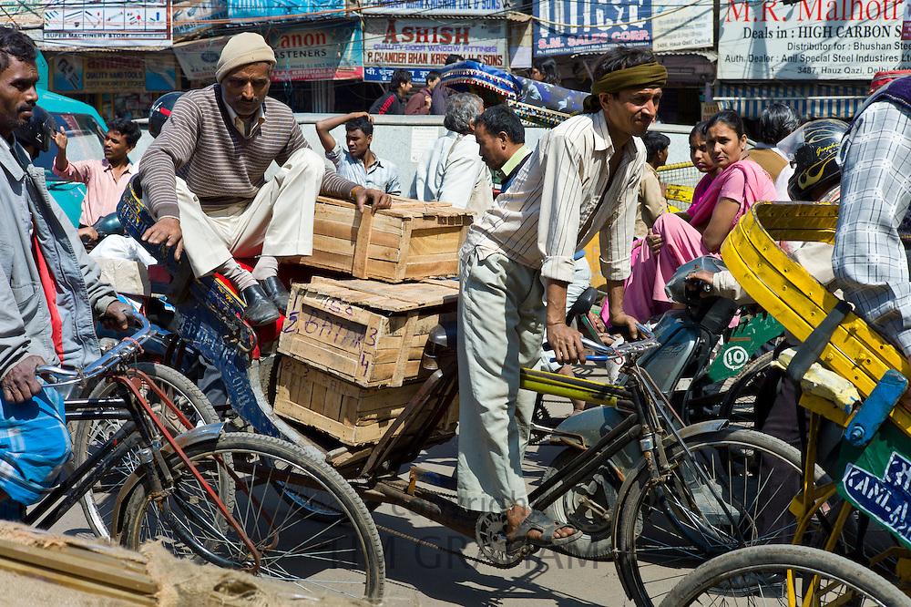 Crowded street scene at Chawri Bazar in Old Delhi, India