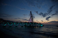 Photo Randy Vanderveen.Puerto Vallarta, Jalisco, Mexico.13-02-01.Los Muertos Pier in Puerto Vallarta against the sunset. The pier re-opened January 2013 after three years.