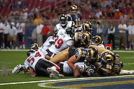 St. Louis Rams running back Wali Lundy (33) is stoped short of the goal line by Houston free safety Kevin Curtis (39) late in the fourth quarter at the Edward Jones Dome in St. Louis, Missouri, August 19, 2006.  The Texans beat the Rams 27-20.