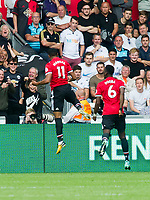 Football - 2017 / 2018 Premier League - Swansea City vs. Manchester United<br /> <br /> Rear view as Anthony Martial of Manchester Utd celebrates scoring his team's 4th goal-their 3rd within 4 minutes, at the end of the game <br /> , at Liberty Stadium.<br /> <br /> COLORSPORT/WINSTON BYNORTH