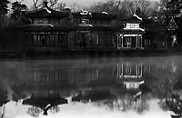 Early morning light hitting pagodas and reflecting on a lake in the grounds of the Imperial Summer Palace, Chengde, China.