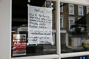 A notice in the window of a restaurant in Paddington advising of its temporary closure due to flooding caused by heavy rain is pictured on 30th July 2021 in London, United Kingdom. Torrential rain on 25th July led to flash flooding across large parts of London.