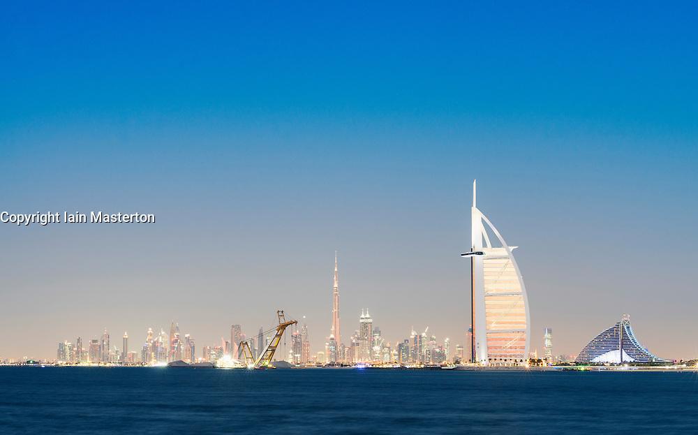 Skyline at night of Dubai waterfront with Burj al Arab Hotel in United Arab Emirates