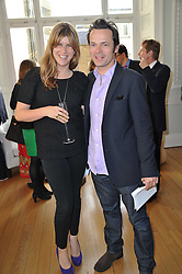 KATE ELLIOT and LUKE IRWIN at a party to celebrate the 60th birthday of Mark Shand and the 50th birthday of Tara the elephant held at 29 Portland Place, London on 25th May 2011.