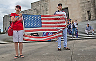 """Lenny & Marlene Stelly holding the flag they flew throughout the Trump years at a 'Stop the Steal' rally in Baton Rouge, LA.  The 'Stop the Steal' rally in Baton Rouge, LA on Nov. 7 held  a couple hours after Biden was declared the winner in the 2020 election against Trump.  Trump supporters believe that the election was stolen and that Trump won.  """"Stop the Steal' rallies were held at State capitols acorss the country."""