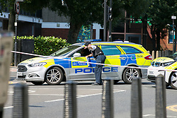© Licensed to London News Pictures. 01/09/2018. London, UK. Police at the Scene on Caledonian Road in London where a woman in her 20's has been stabbed in broad daylight. Police were called to the scene shortly before 10.30am today. Photo credit: Dinendra Haria/LNP