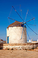 The Windmills overlooking  Chora town. Ios Cylcades Islands, Greece. .<br /> <br /> Visit our GREEK HISTORIC PLACES PHOTO COLLECTIONS for more photos to download or buy as wall art prints https://funkystock.photoshelter.com/gallery-collection/Pictures-Images-of-Greece-Photos-of-Greek-Historic-Landmark-Sites/C0000w6e8OkknEb8