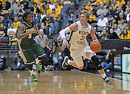 WICHITA, KS - NOVEMBER 14:  Guard Ron Baker #31 of the Wichita State Shockers brings the ball up court against guard Marcus Thornton #3 of the William & Mary Tribe during the first half on November 14, 2013 at Charles Koch Arena in Wichita, Kansas.  (Photo by Peter G. Aiken/Getty Images) *** Local Caption *** Ron Baker;Marcus Thornton