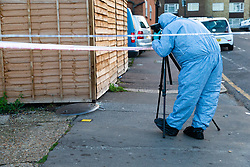 A forensics investigator photographs an adjacent side street   following a stabbing at a Costa Cafe On Bowes Road, Arnos Grove  in which a male victim has been left in critical condition. Arnos Grove, North London, November 12 2018.