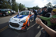 June 30, 2013 - Pikes Peak, Colorado. Paul Dallenbach celebrates with fans after the 91st running of the Pikes Peak Hill Climb.