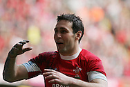 Stephen Jones of Wales shows his delight after victory. RBS Six nations championship 2010, Wales v Italy at the Millennium Stadium in Cardiff  on Sat 20th March 2010. pic by Andrew Orchard, Andrew Orchard sports photography,
