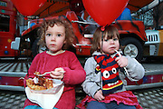 NO FEE PICTURES <br /> 30/12/14 Emily, age 4 and her sister Charlotte Costello, age 2, Killiney pictured at the New Years Festival Food Village. NYF Food Village will run over 3 days from 12noon until 9pm at Barnardos Square (Dame Street). Come along and enjoy the 3 day NYF Food Village in Barnardos Square beside the beautiful backdrop of City Hall, Dame Street. Starting at 12 noon, treat yourself to delicious artisan food and enjoy a coffee as you sit back and be entertained by stunning 3D Light projections at Luminosity!*FREE ADMISSION   FAMILY FRIENDLY. Picture:Arthur Carron