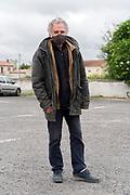 outdoors farmers market food seller portrait during Covid 19 crisis France Limoux April 2020