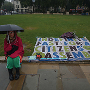 Earthfest continues hunger strike on the 18 days sitting in the rain with an umbrella, Activist will continuues until she die or the government meet their demand Parliament square, London, UK. 2019-09-14.