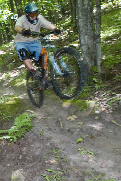Mountain bikers navigate a wooded trail while freeriding near Marquette, Michigan.