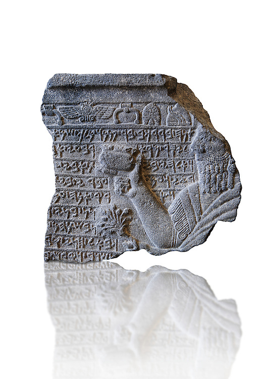 Fragment of a relief panels orthostat with a representation and inscription of Prince Barrakib by Sam 'al /Zincirli. At the top of the panel are symbols of various God's. Neo Syro Hittite.  Basalt around 730 BC. Pergamon Museum, Berlin. Inv S6581