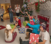 """Junior class advisors Suzanne Kiefer and Amy Bennett toss Kylee Powers, Becca Kendall, Emina Karabegovic, John Hammond and Nicole Bogert (in the white cap) gifts as they deck the halls of Laconia High School with their """"Christmas"""" holiday theme for Friday's Homecoming festivities.    (Karen Bobotas/for the Laconia Daily Sun)"""
