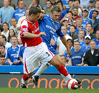 Photo: Ed Godden.<br />Chelsea v Charlton Athletic. The Barclays Premiership. 09/09/2006. Chelsea's Andriy Shevchenko (R) battles with the Charlton Captain Luke Young.